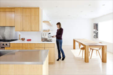Interior / architectural photograph of a woman in her kitchen